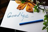 stock photo of bye  - Hand written message Good Bye on a piece pf paper concept of relationship - JPG