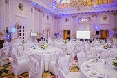 foto of wedding table decor  - image of tables setting at luxury wedding hall - JPG