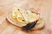 image of crepes  - Crepes on wooden vintage kitchen board - JPG