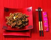 picture of stir fry  - Vietnamese beef stir fry served on a bamboo place mat - JPG