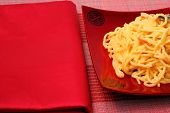 picture of carbonara  - spaghetti carbonara served on a bamboo place mat - JPG