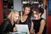 image of x-rated  - Three young female students surprised while looking at a computer - JPG