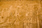 image of isis  - Frieze at the Temple of Seti I of the Ancient Egyptian gods Amun Ra - JPG