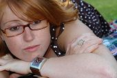 foto of clevage  - a beautiful redhead with glasses feeling sad and depressed - JPG