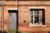 stock photo of west midlands  - Broken glass in old warehouse - JPG