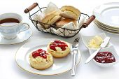 stock photo of devonshire  - scone with strawberry jam and clotted cream  - JPG