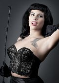 picture of riding-crop  - Gorgeous pin up model in sexy black lingerie holding riding crop - JPG