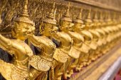 image of garuda  - The wall with statues of golden garuda Wat Phra Keo Bangkok Thailand - JPG