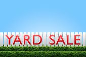 image of yard sale  - Yard Sale sign on white fence and blue sky - JPG