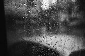 stock photo of rainy day  - shot taken on a rainy day from the back of a bus - JPG