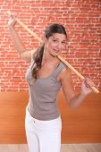 pic of transpiration  - young woman doing fitness with a stick - JPG