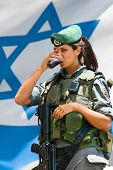 JERUSALEM, ISRAEL - MAY 30: Unidentified Israeli army girl at the Israel Expo, one of the largest ce