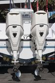 foto of outboard engine  - A motor boat showing off its outboards - JPG