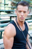 stock photo of bleachers  - portrait of a young athletic man with jump rope on bleachers - JPG