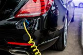 Ev Car Or Electric Car At Charging Station With The Power Cable Supply Plugged In, Charging Hybrid C poster