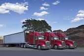 image of 18-wheeler  - The beautiful Three 18 Wheeler Red Semi - JPG