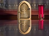 stock photo of eucharist  - Golden tabernacle on the altar of a country church - JPG