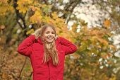 Feel Cozy In Warm Jacket. Girl Happy Wear Coat With Hood Enjoy Fall Nature. Child Wear Coat For Fall poster