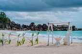 Beach Wedding Arch Ceremonial Decorated With White Flowers On A Tropical White Sand Beach. Paradise  poster