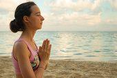 Namaste Mudra. Close Up. Yoga At The Beach. Young Woman Meditating, Practicing Yoga And Pranayama Wi poster