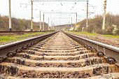 Railway Track. Railway Rails Of The Station With A Blue Sky With Clouds poster
