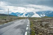 Camper Car In Norwegian Mountains. Tourism Vacation And Travel. Caravan Car Rv Travels On The Mounta poster