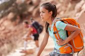 Hike travel Asian hiker woman carrying heavy backpack tired on outdoor trek in Grand Canyon trail wa poster