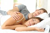 Happy Couple Sleeping Together In A Comfortable Bed In The Morning At Home Or Hotel Room poster