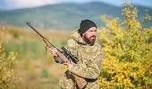 Hunter Hold Rifle. Bearded Hunter Spend Leisure Hunting. Focus And Concentration Of Experienced Hunt poster