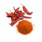 Heap of dried red chili peppers and a heap of chili powder isolated on white background poster
