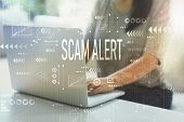 Scam Alert With Woman Using Her Laptop In Her Home Office poster