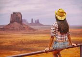 Cowgirl woman enjoying view of Monument Valley in cowboy hat. Beautiful young girl in outdoors, Ariz poster