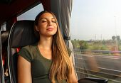 Beautiful Woman Relaxing And Sleeping Sitting In Comfortable Bus. Bus Or Train Passenger Traveling S poster