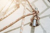 Rope On A Yacht. Yacht Rope Cleat And Sunlight. Sailboat Winch And Rope Yacht Detail. Yachting. poster