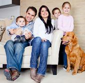 stock photo of puppies mother dog  - Big family at home with a dog - JPG