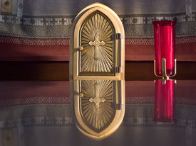 pic of tabernacle  - Golden tabernacle on the altar of a country church - JPG