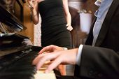 image of serenade  - Man playing piano for his girlfriend - JPG