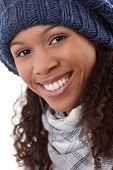 foto of knitted cap  - Closeup portrait of smiling young afro woman in knitted cap - JPG