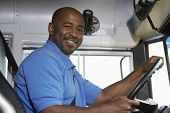 stock photo of bus driver  - Portrait of an African American handsome bus driver smiling - JPG