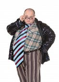 pic of outrageous  - Fun portrait of an obese man with an outrageous fashion sense wearing a mixture of stripes checks and spangles topped by an oversized flamboyant tie on white - JPG