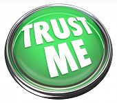 A round green button in metal and light reading Trust Me to symbolize trustworthiness, good reputati