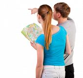 stock photo of backside  - Back view journey of the young couple looking at the map - JPG