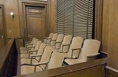 stock photo of proceed  - Side view of a empty jury box in the courthouse - JPG