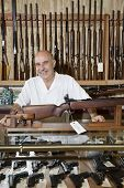 stock photo of gun shop  - Portrait of happy middle - JPG