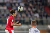 VIENNA,  AUSTRIA - SEPTEMBER 11 Emanuel Pogatetz (#4 Austria) heads the ball during the WC qualifier
