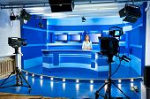picture of mass media  - a television announcer at studio during live broadcasting - JPG