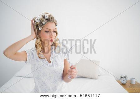 Gorgeous blonde wearing hair curlers
