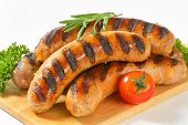 picture of sausage  - portion of grilled sausages served on cutting board - JPG