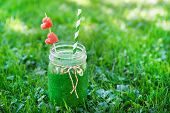 stock photo of smoothies  - Spinach green smoothie as healthy summer drink - JPG