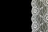 White Lace Over Black Background.